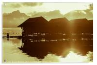 Sun rising over cute little wooden huts perched on, Acrylic Print