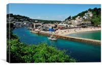A boat head back up the River Looe in Cornwall, Canvas Print