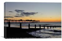 Silhouetted sunrise  of Teignmouth Pier and Groyne, Canvas Print