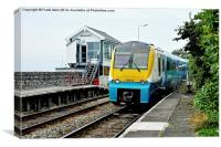An Arriva train arriving at Deganwy Station, Canvas Print
