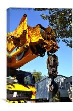 Crane preparing to lift a caravan
