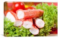 Pile of crab sticks surimi imitation on lettuce , Canvas Print