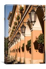 Row of lamps on columns of building , Canvas Print
