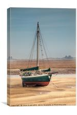 Sail boat stranded at low tide on sand, Canvas Print