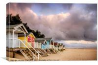 Colourful beach huts on golden sand coast, Canvas Print