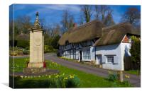 Thatched Cottage and War Memorial Wherwell,Hampshi, Canvas Print