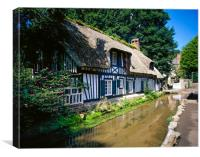 Half timber frame house with stream Normandy Fra, Canvas Print
