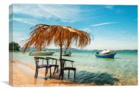 Сhairs under thatched umbrellas in a turquoise sea, Canvas Print