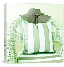 Hat on wicker chair with cushion, Canvas Print