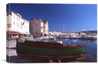 Green boat under dramatic sunny noon in St. Tropez, Canvas Print