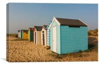 Colourful beach huts on the sand at Southwold , Canvas Print