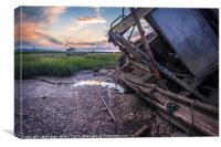 A beautiful sunset looking at an old wooden boat , Canvas Print