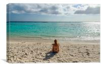 Woman relax in front of the Caribbean Sea in Aruba, Canvas Print