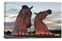 Kelpies at dusk floodlit in Red., Canvas Print