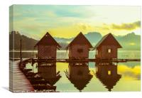 Sun rising over cute little wooden huts perched on, Canvas Print
