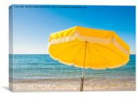 Giant yellow beach umbrella next to the ocean agai, Canvas Print
