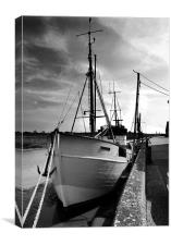 Boat moored at Snape Maltings dock