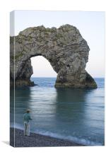 Man fishing at Durdle Door near Lulworth cove., Canvas Print