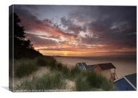 Beach huts and sunset.