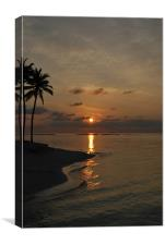 Sun setting behind clouds - Maldives