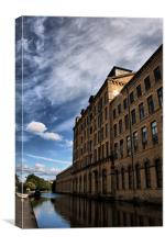 salts mill towering over leeds liverpool canal