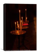 Lit candles in a church, Canvas Print