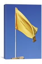 Yellow flag fluttering in blue sky, Canvas Print