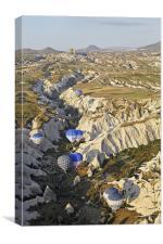 Hot air balloons drifting through a Gorge, Canvas Print