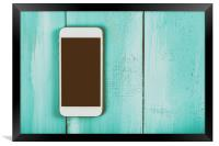 White Mobile Phone With Blank Screen On Wood Table, Framed Print