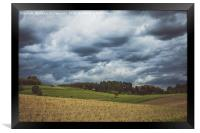 Stormy cloudscape over fields and pasture , Framed Print