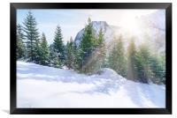 Sun rays through snowy mountains and trees, Framed Print