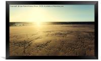 Sunset sun illuminating the sand of the beach, Framed Print