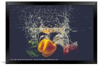 Green Yellow Red bell peppers drop into the water , Framed Print