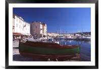 Green boat under dramatic sunny noon in St. Tropez, Framed Mounted Print